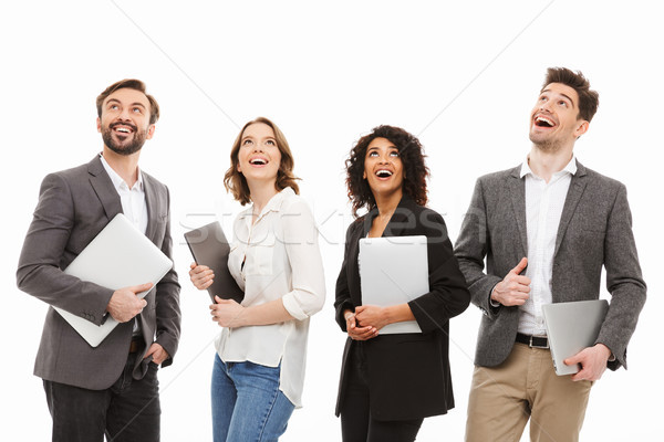 Portrait of a group of happy multiracial business people Stock photo © deandrobot