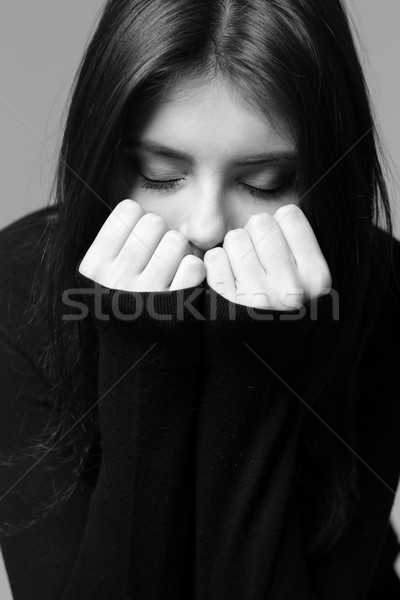 Black and white closeup portrait of a nervous woman Stock photo © deandrobot