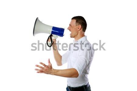 Vista lateral homem gritando megafone branco fundo Foto stock © deandrobot