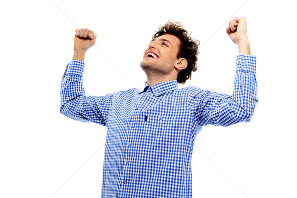Cheerful man with raised hands up on a white background Stock photo © deandrobot