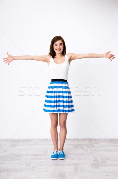Teljes alakos portré fiatal boldog lány örvend lát Stock fotó © deandrobot
