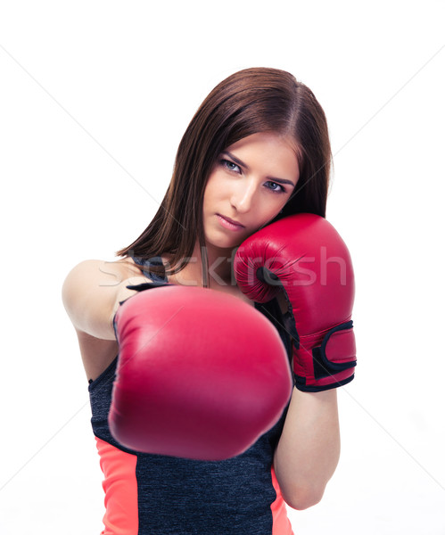 Pretty woman punching in camera with boxing glove Stock photo © deandrobot