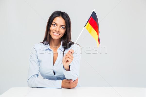 Zakenvrouw vergadering tabel Duitsland vlag Stockfoto © deandrobot
