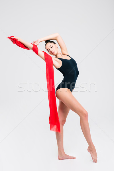 Acrobat femme gymnaste costume posant isolé Photo stock © deandrobot