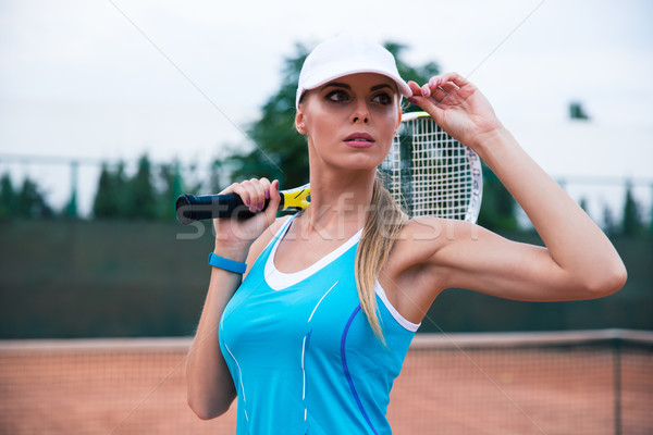 Stock photo: Woman playing in tennis outdoors