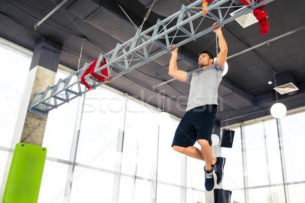Fitness homem ginásio esportes quarto Foto stock © deandrobot