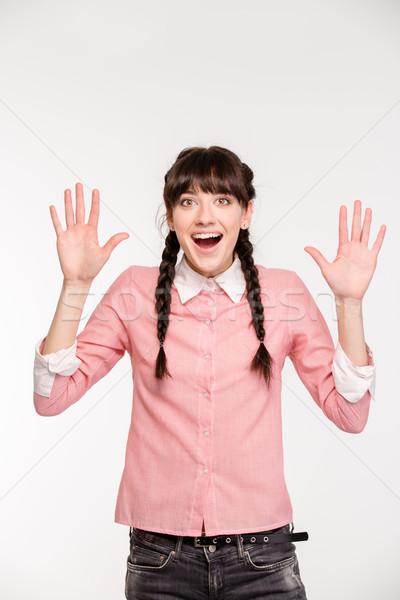 Maravilhado mulher em pé as mãos levantadas para cima retrato Foto stock © deandrobot