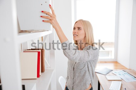 Sensual young woman takig photo of herself using mobile phone Stock photo © deandrobot