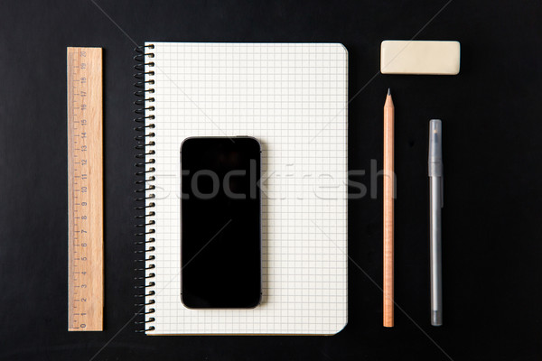 Top view of school supplies and blank screen mobile phone  Stock photo © deandrobot