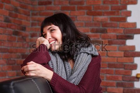 Pretty smiling yung female in grey knitted scarf  Stock photo © deandrobot
