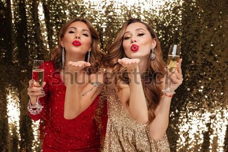 Derűs gyönyörű fiatal nők buli küldés csók Stock fotó © deandrobot