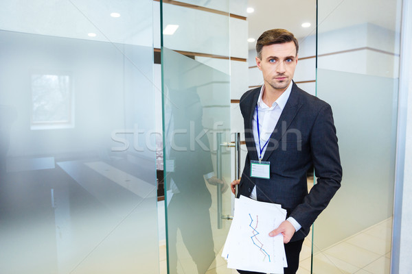 Serious business man entering the meeting room Stock photo © deandrobot