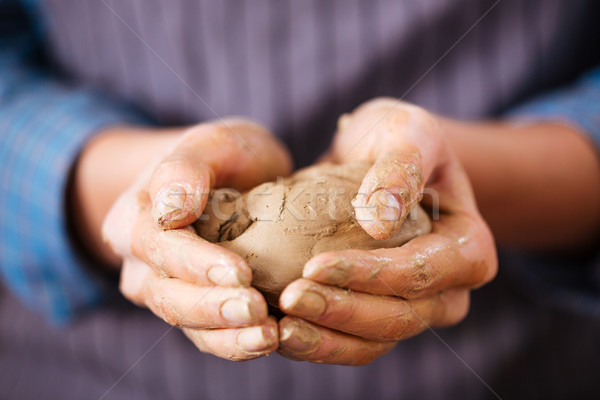 Young woman potter hands holding piece of clay  Stock photo © deandrobot