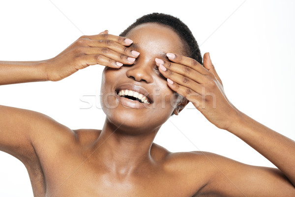 Cheerful afro american woman covering her eyes Stock photo © deandrobot