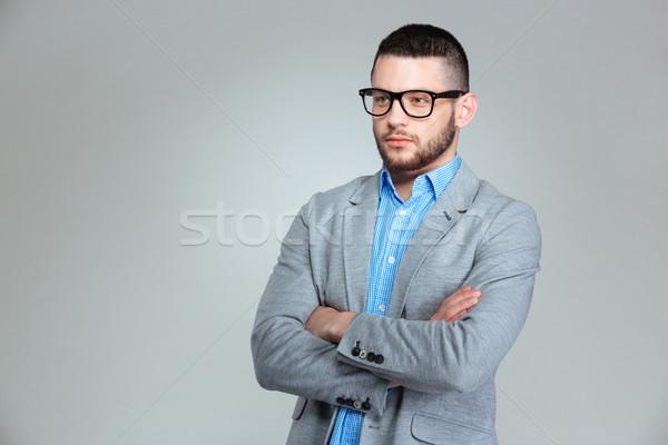 Pensieroso imprenditore piedi braccia piegato grigio Foto d'archivio © deandrobot