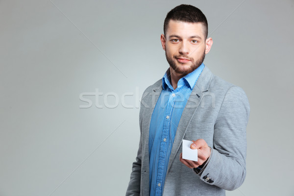 Stock photo: Businessman giving blank card at camera