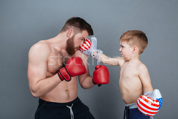 Dad and son playing using boxing gloves together Stock photo © deandrobot