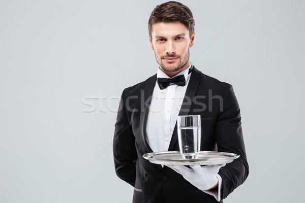 Kellner Smoking halten Glas Wasser Metall Stock foto © deandrobot