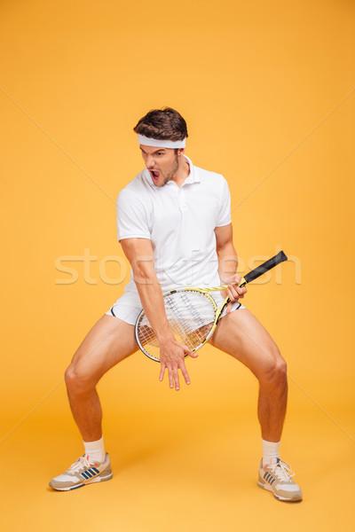 Vicces fiatalember teniszező ütő játszik gitár Stock fotó © deandrobot