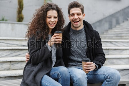 Portrait of a smiling young couple looking at camera Stock photo © deandrobot