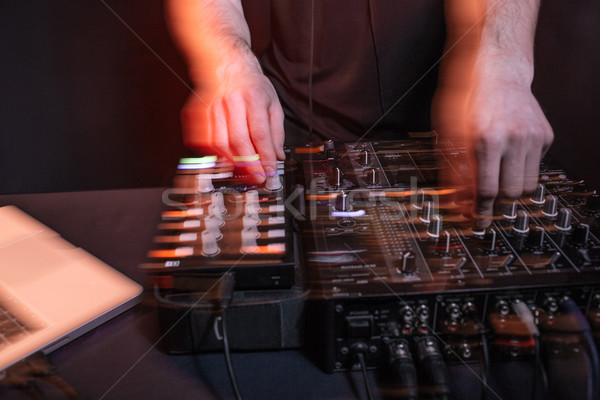 Dj playing music in nightclub Stock photo © deandrobot