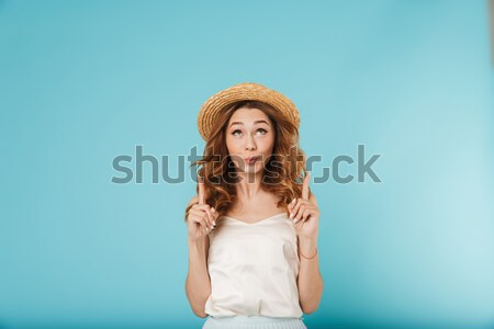 Beautiful young woman with long hair posing Stock photo © deandrobot