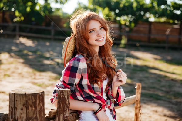 Cheerful beautiful young woman cowgirl on ranch Stock photo © deandrobot