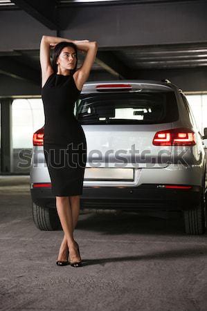 érzéki fiatal nő pózol autó parkolás teljes alakos Stock fotó © deandrobot