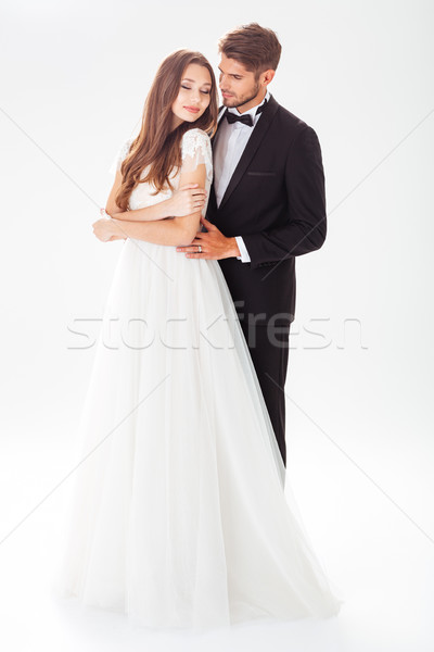 Full-length image of pretty newlyweds Stock photo © deandrobot