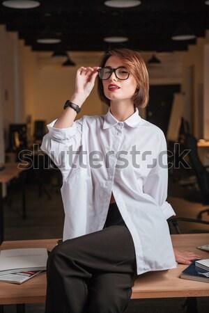 заманчивый молодые деловая женщина сидят таблице служба Сток-фото © deandrobot