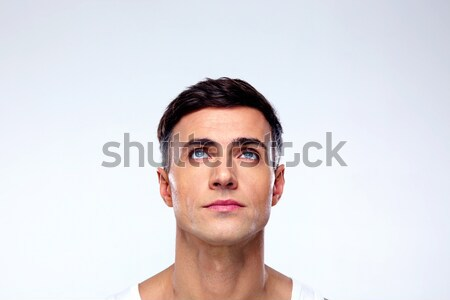 Close up portrait of a focused man looking at camera Stock photo © deandrobot