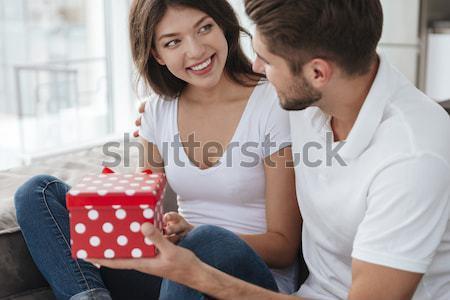 Heureux homme présents petite amie maison jeune homme Photo stock © deandrobot