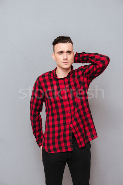 Vertical image of displeased man in shirt Stock photo © deandrobot