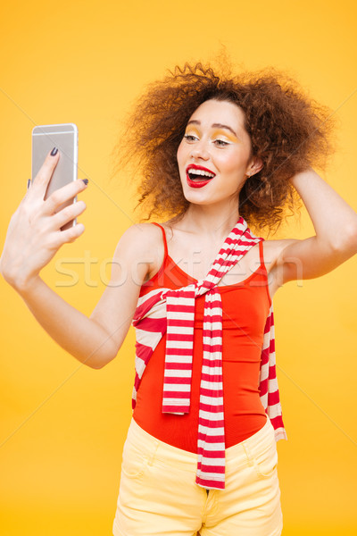 Stock photo: Vertical image of Bright model making selfie