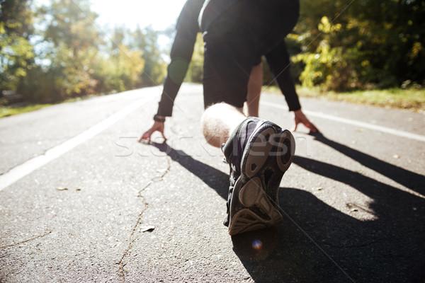 Runner preparing to run Stock photo © deandrobot