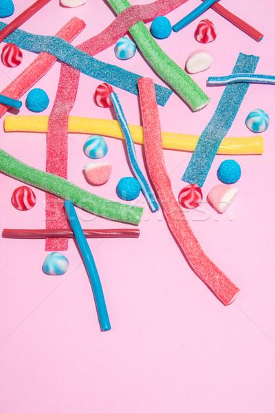 Felső kilátás vegyes színes cukorkák copy space Stock fotó © deandrobot