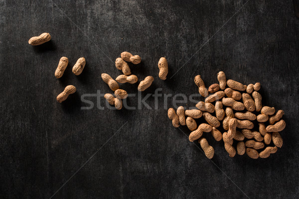 Top view image of dried peanuts Stock photo © deandrobot