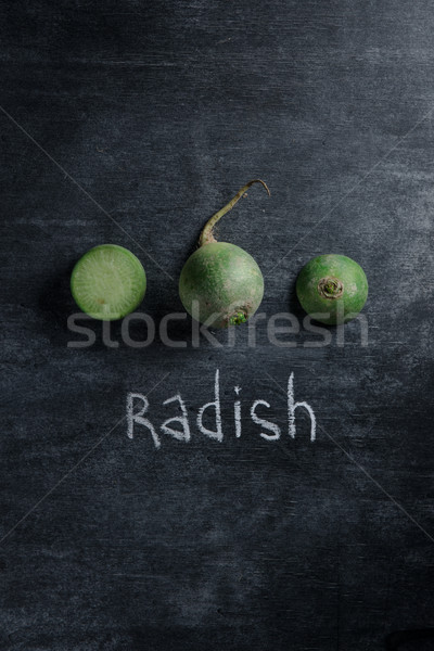 Top view of the cut radish over dark background Stock photo © deandrobot