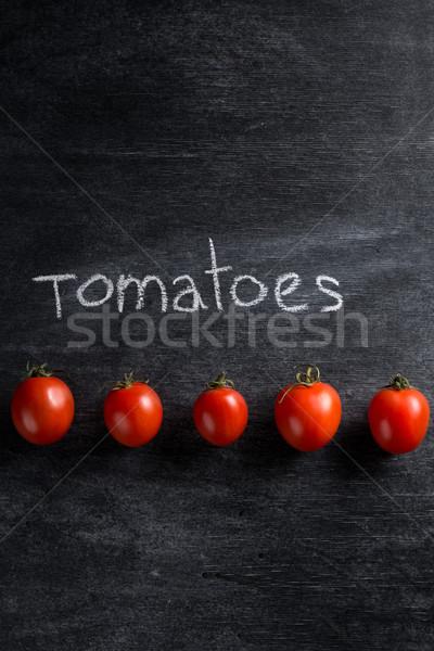 Imagen tomates oscuro superior vista salud Foto stock © deandrobot