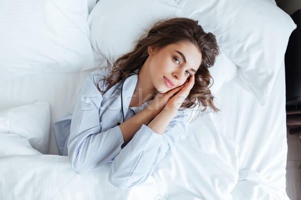 Młodych brunetka kobieta piżama relaks bed Zdjęcia stock © deandrobot