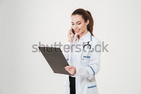 Photo stock: Jeunes · Homme · médecin · utilisant · un · ordinateur · portable · ordinateur