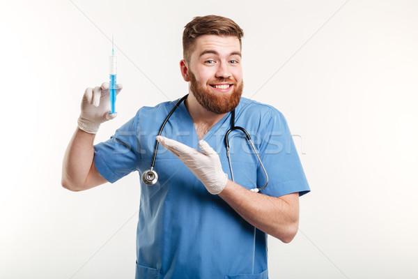 Portrait of a happy attractive medical doctor or nurse Stock photo © deandrobot