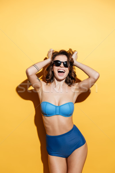 Cheerful young woman in swimwear Stock photo © deandrobot