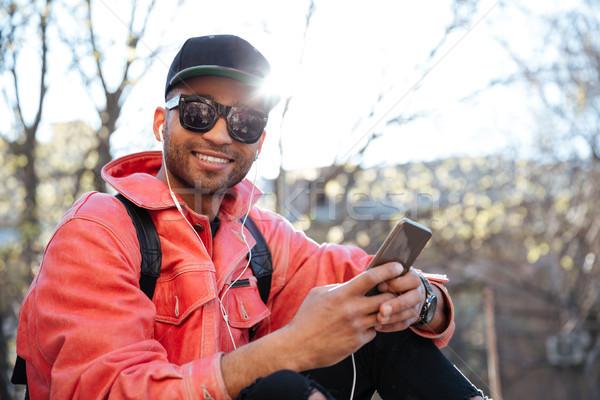 молодые афро американский человека Cap Сток-фото © deandrobot