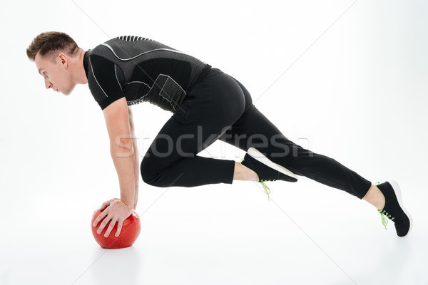 Side view full length portrait of a young muscular sportsman Stock photo © deandrobot