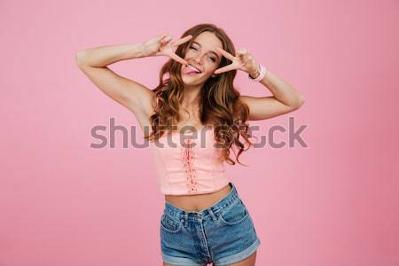 Portrait of a smiling young woman in summer clothes Stock photo © deandrobot