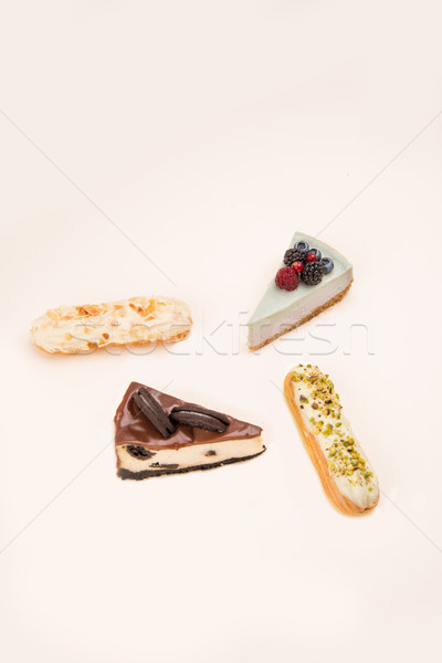Four different desserts isolated over white Stock photo © deandrobot