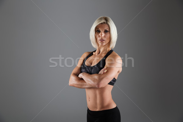 Portrait of a concentrated adult sportswoman Stock photo © deandrobot