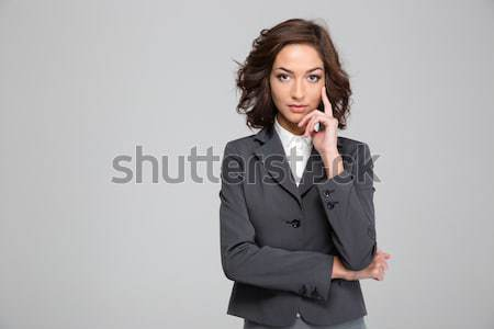 Portrait of a unsatisfied confused businesswoman in eyeglasses and suit Stock photo © deandrobot