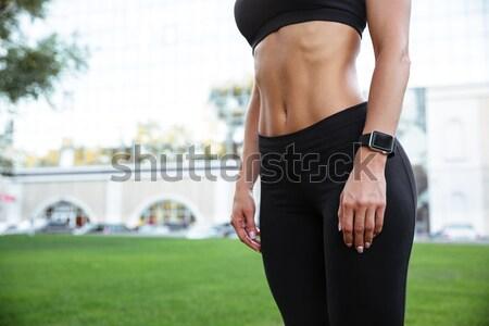 Foto fuerte jóvenes deportes mujer pie Foto stock © deandrobot